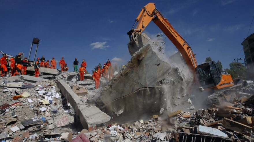 <p>Rescuers work to save people from debris in Ercis, Van, eastern Turkey. A 7.2-magnitude quake that struck Sunday has killed at least 272 people in eastern Turkey.</p>