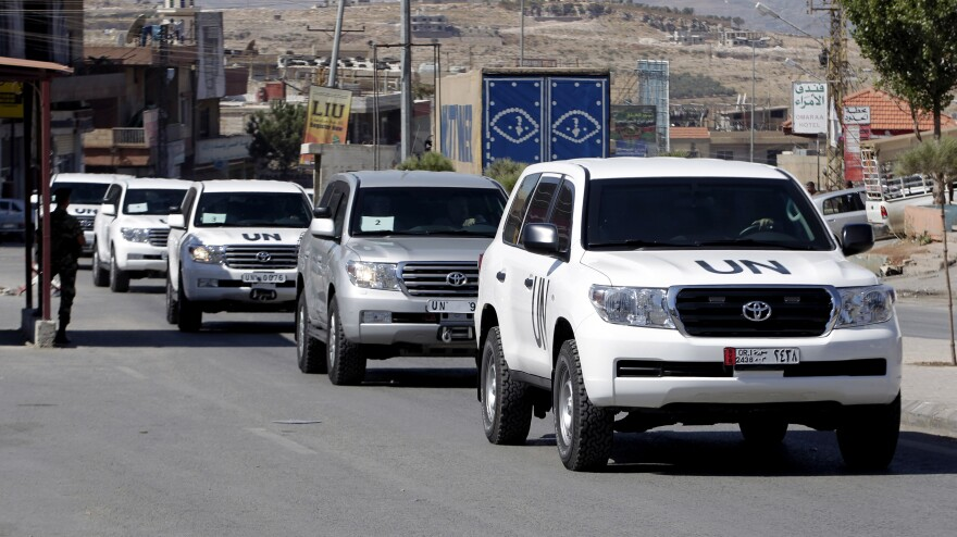 A convoy of inspectors from the Organisation for the Prohibition of Chemical Weapons moves into Syria at the Lebanese border crossing point of Masnaa on Tuesday.