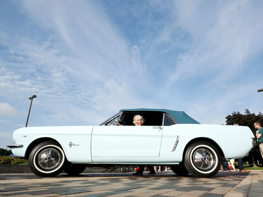 Gail Wise sits in her 1964 Mustang as Ford celebrates the production of the 10 millionth Mustang at in August 2018.