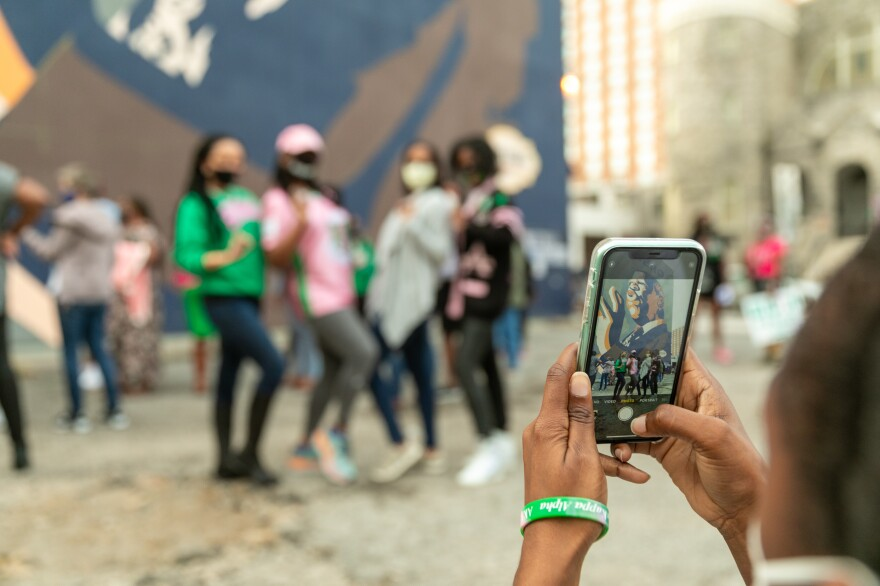 <strong>ATLANTA</strong>: Members of Alpha Kappa Alpha Sorority get their photo taken in front of the mural of the late Rep. John Lewis.