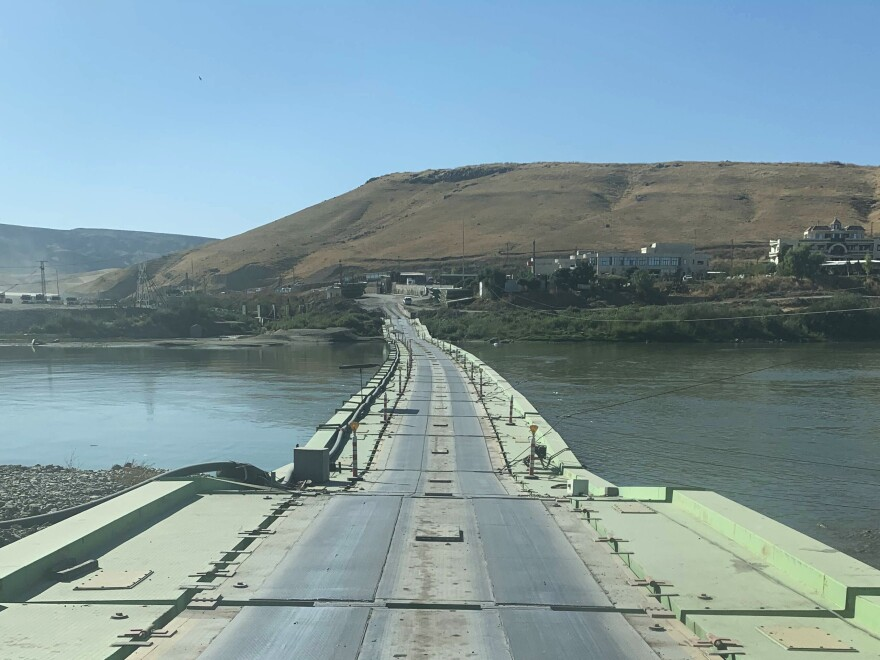 Crossing the bridge over the Tigris river into Syria from Iraqi Kurdistan.
