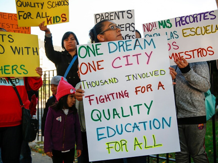 Parents, students and supporters of Chicago Public Schools teachers gather at a press conference in 2016 near Mayor Rahm Emanuel's home.