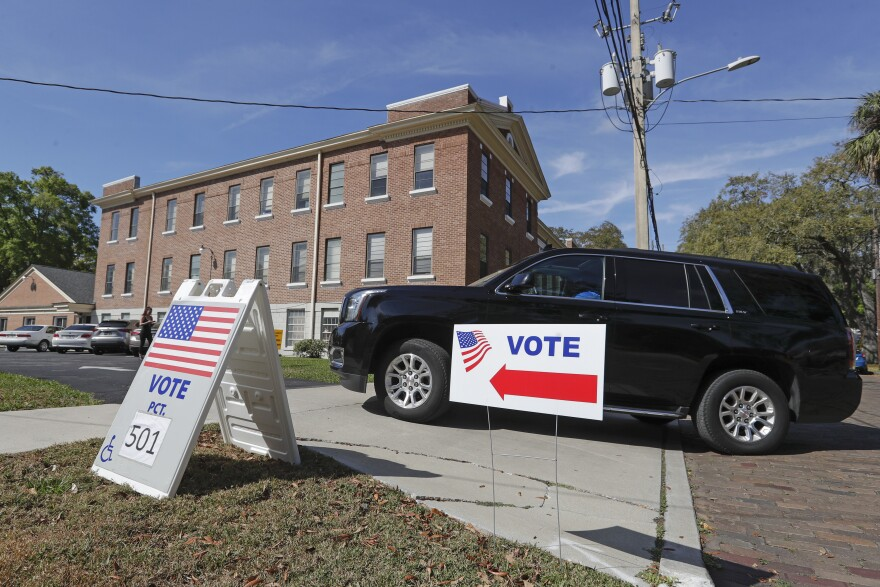 Black SUV Driving into Polling Station