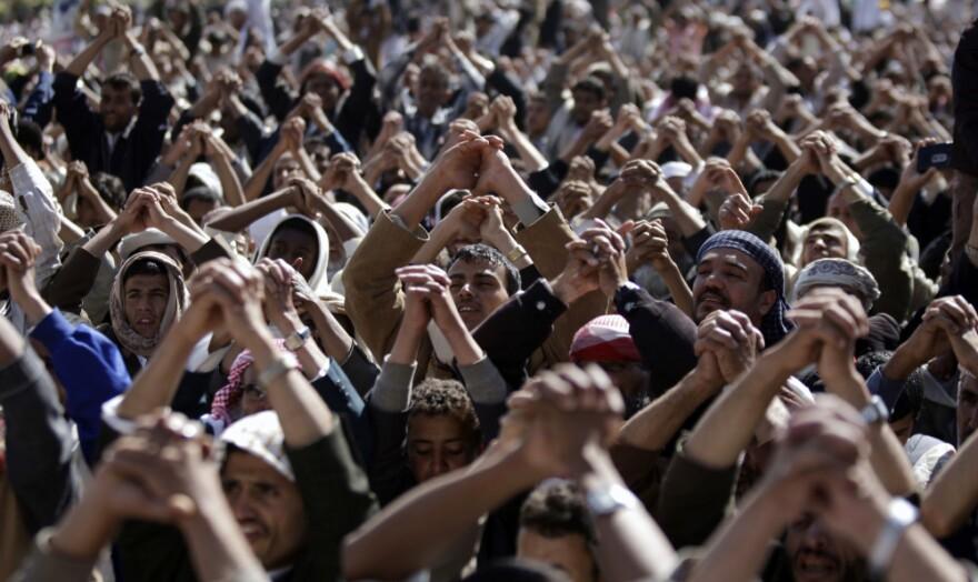 Protestors gesture during a demonstration demanding the prosecution of Yemen's President Ali Abdullah Saleh in Sanaa on Friday.