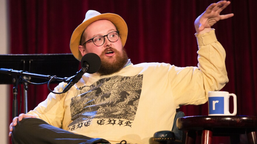 Dan Deacon plays a game with Ophira Eisenberg on <em>Ask Me Another</em> at the Bell House in Brooklyn, New York.