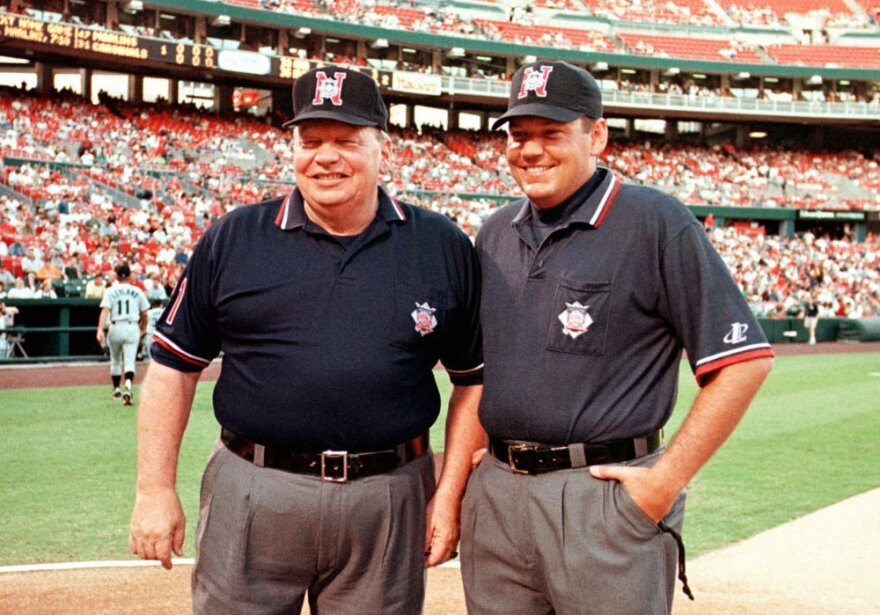 This 1998 file photo shows veteran National League umpire Harry Wendelstedt, left, with his son, Hunter Wendelstedt, also an umpire.