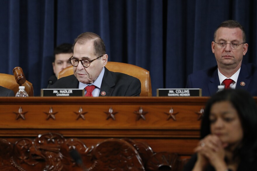 House Judiciary Committee Chairman Rep. Jerrold Nadler, D-N.Y., left, gavels the hearing to a close after the House Judiciary Committee voted on the articles of impeachment against President Donald Trump, Friday, Dec. 13, 2019, on Capitol Hill in Washington. House Judiciary Committee ranking member Rep. Doug Collins, R-Ga., is right. (Andrew Harnik/AP)