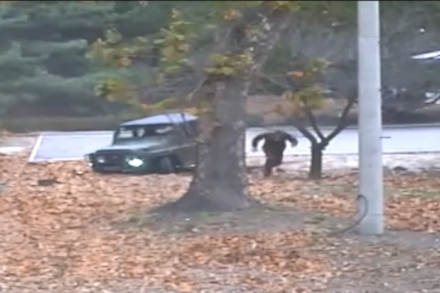 Newly released closed-circuit television footage shows a North Korean soldier sprinting south across the border last week while his fellow soldiers fire on him.