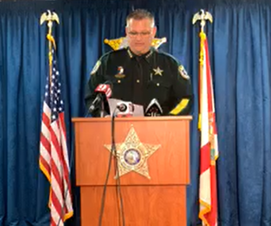 Sheriff stands at podium