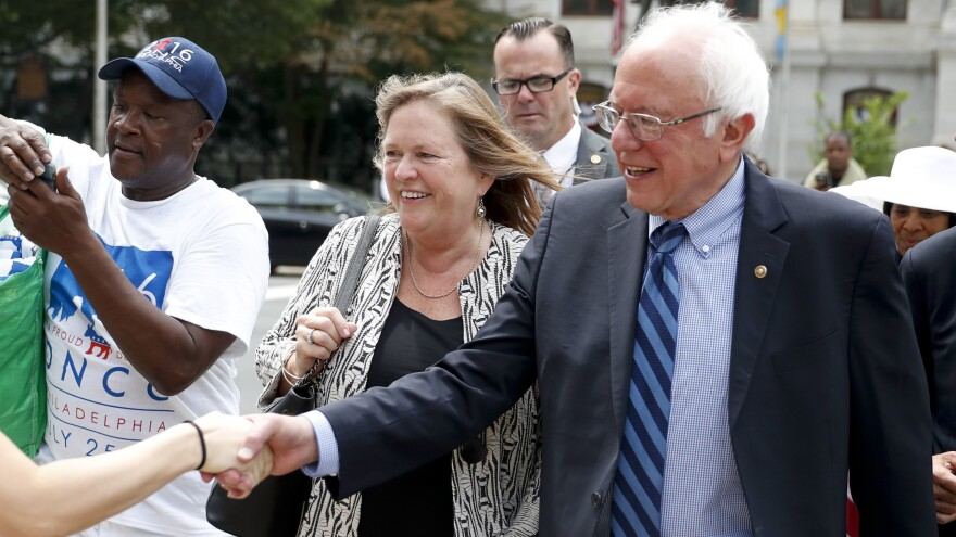 Sen. Bernie Sanders, I-Vt., right, shakes hands with a supporter in downtown Philadelphia during the final day of the Democratic National Convention. (AP Photo/John Minchillo)