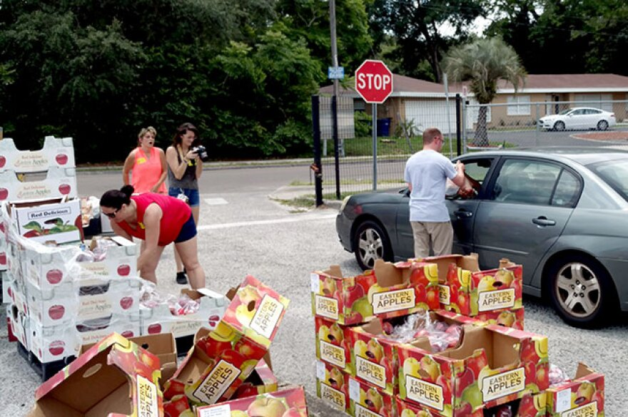 """Feeding Tampa Bay hands out food at Foster and dozens of other local schools where students and even teachers and staff are """"food insecure."""""""