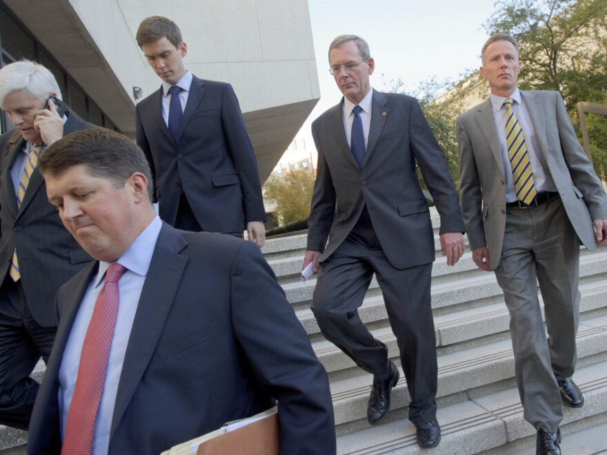 David Rainey, second from right, leaves Federal Court after being arraigned on obstruction of a federal investigation in New Orleans in 2012. Rainey was acquitted Friday.