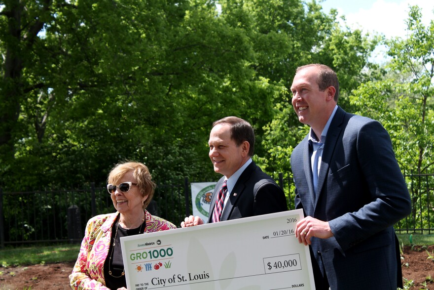 Joan Crigger of the U.S. Conference of Mayors and Brad Rethman of Scotts Miracle-Gro present a check to Mayor Francis Slay on Wednesday, May 4, 2016.