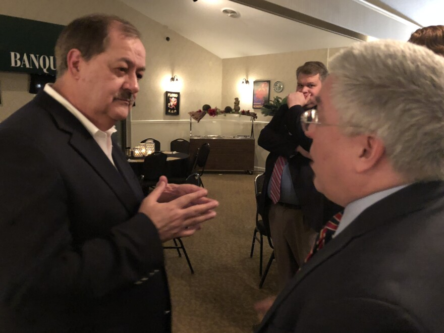 Don Blankenship, left, talks to Patrick Morrisey, right, after a heated exchange at a campaign stop in Parkersburg, W.Va.