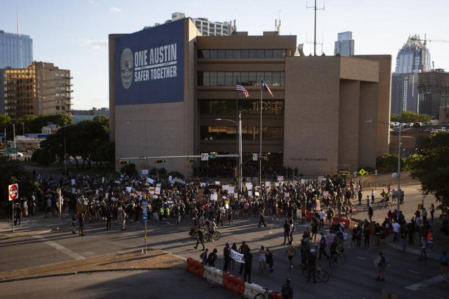 Demonstrators gather outside Austin Police Department headquarters on June 4 to protest the police killing of George Floyd.