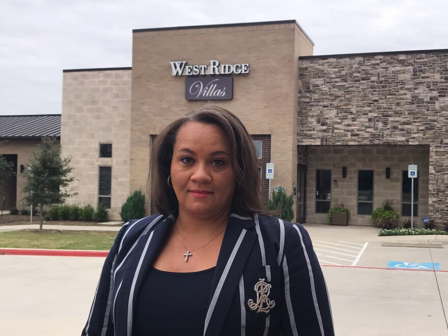 Developer Terri Anderson stands in front of the rental office of the apartment complex she fought to get built near two wealthy Dallas suburbs in 2016. Back then, Anderson faced fierce opposition to the project, which has units set aside for Section 8 voucher holders.