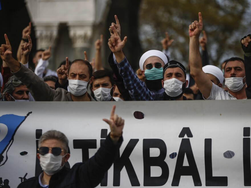 Demonstrators chant slogans during an anti-France protest in Istanbul on Sunday, as tensions rise between the two countries.