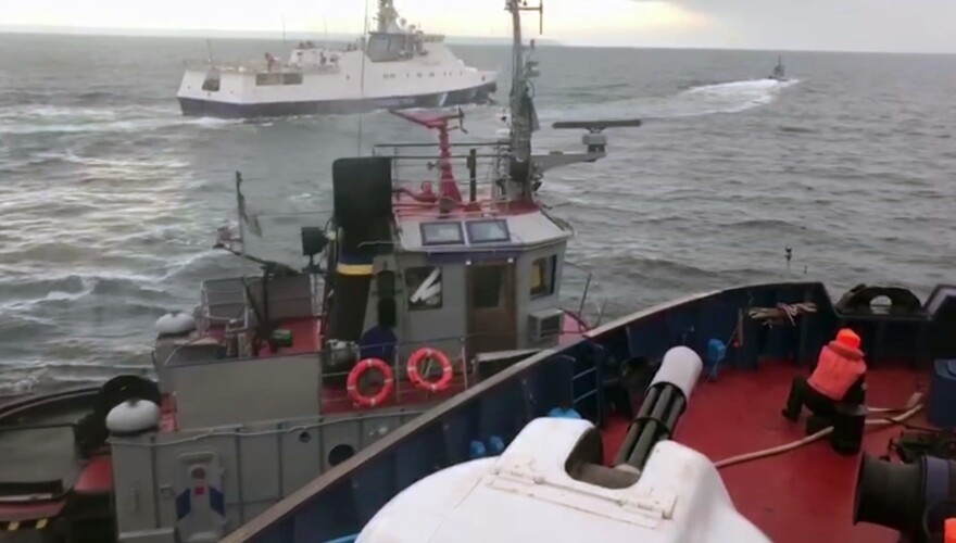 An image from video released by Russia's Federal Security Service taken from a Russian coast guard vessel shows an incident between the Russian coast guard and a Ukrainian tugboat in the Kerch Strait on Nov. 25.