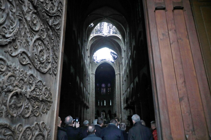 The interior of the Notre Dame Cathedral in Paris is seen on Monday. Hundreds of millions of euros have already been pledged to restore the historic masterpiece.