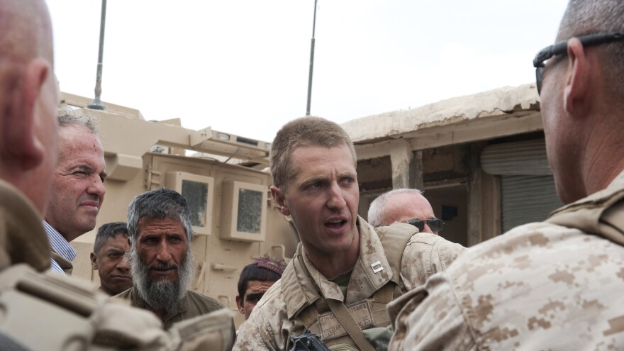 Jason Brezler in the market of Nowzad on May 7, 2010, with village elders, Afghan National Police and U.S. Marines. Maj. Brezler is now facing a possible discharge from the Marines after he emailed classified documents.