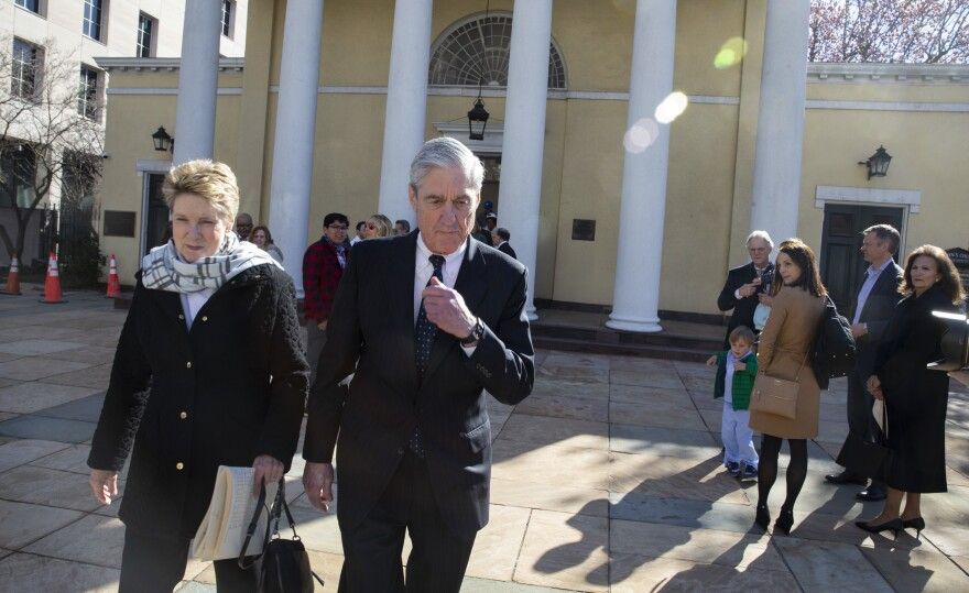 Special counsel Robert Mueller walks with his wife, Ann, in Washington, D.C., on Sunday. The Justice Department is expected to send a summary of his findings to Congress.