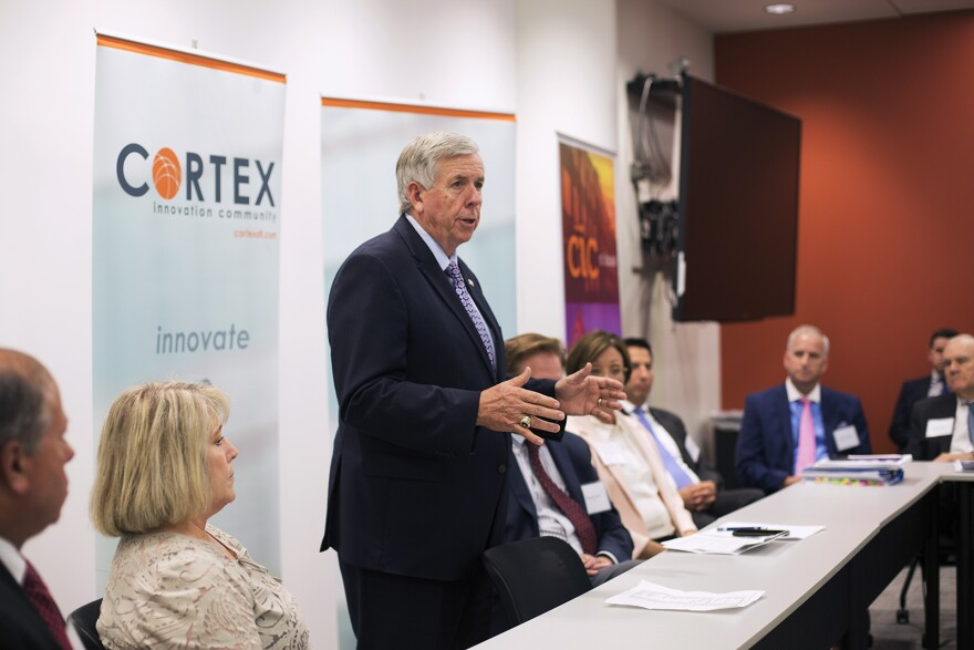 Gov. Mike Parson greets attendees at a meeting at Cortex Innovation Community.