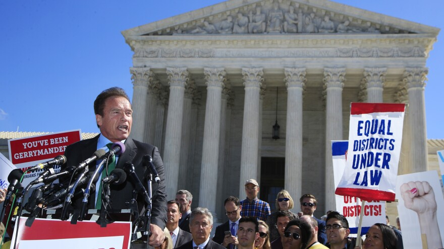 Former California Gov. Arnold Schwarzenegger speaks at a rally outside the U.S. Supreme Court in October on the day arguments took place in a case about political maps in Wisconsin.