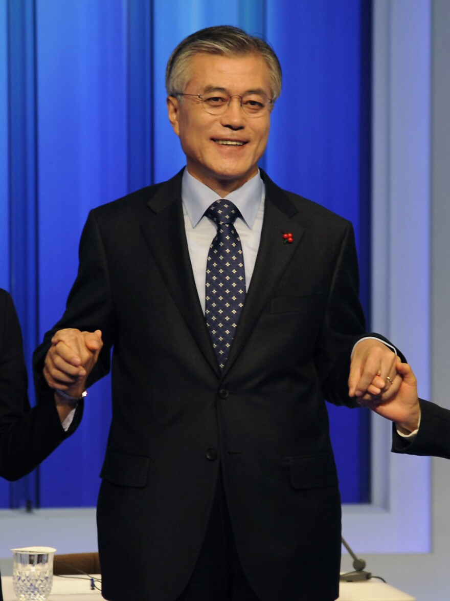 Moon Jae-in, a former human rights lawyer, is also a leading candidate in Wednesday's election. A former presidential chief of staff, he's shown here at a presidential debate on Dec. 4.