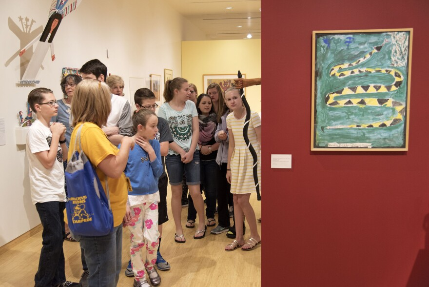 Barrackville Middle School students tour Ramona Lampell's collection of Appalachian self-taught artists' work at the Art Museum of West Virginia University.