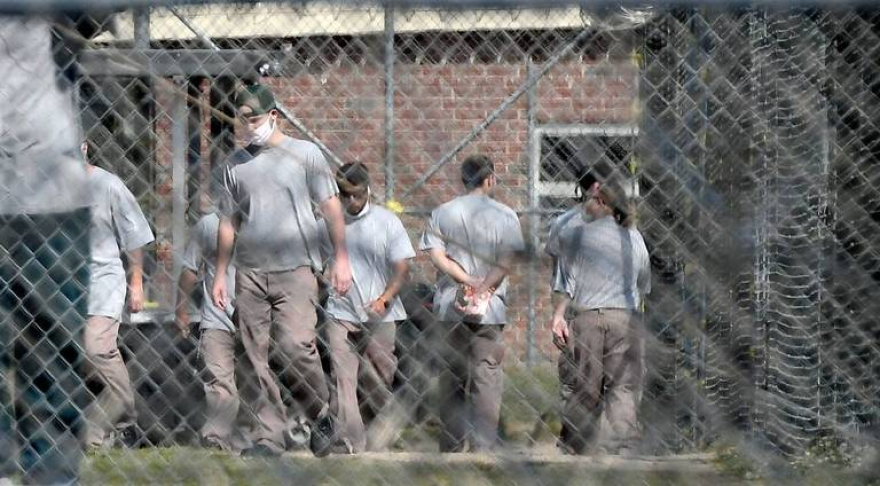 Inmates at Neuse Correctional Institution, in Goldsboro, move between buildings during pandemic.