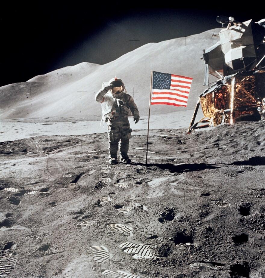 Astronaut David Scott, commander of Apollo 15, salutes the American flag at the mission's Hadley-Apennine landing site, on Aug. 1, 1971.