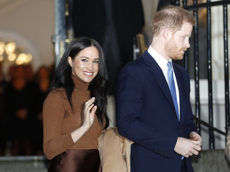 Britain's Prince Harry and Meghan, the Duchess of Sussex, depart from a visit to Canada House in London on Jan. 7.