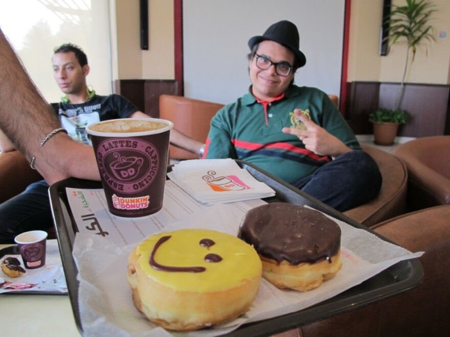 A group of Saudi youth make an early morning stop at a Jeddah Dunkin' Donuts after spending the night partying on the beach.