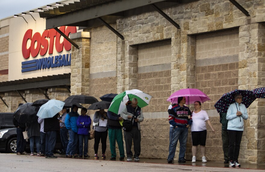 A line of shoppers waits to enter Costco in South Austin during the coronavirus pandemic.