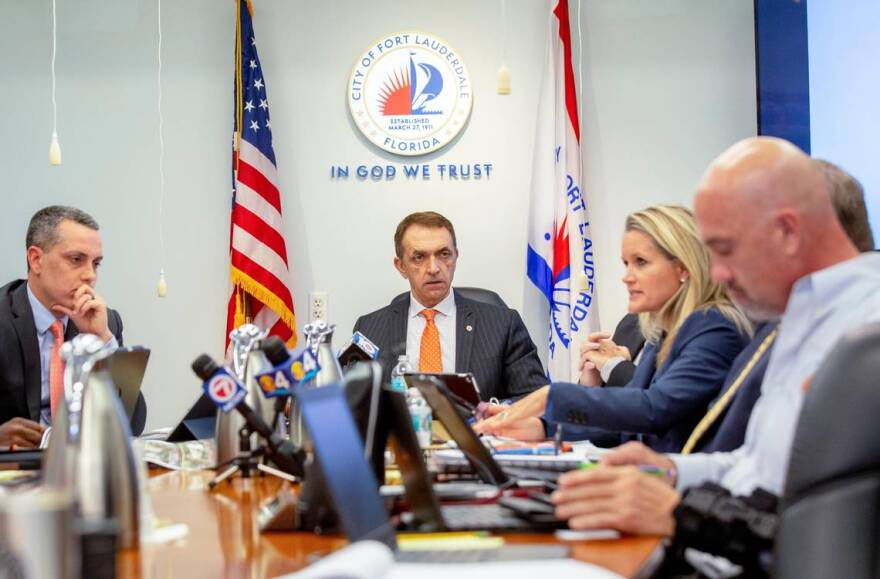 Fort Lauderdale Mayor Dean Trantalis, center, listens to city commissioners discuss solutions for the recent sewage spills at City Hall in Fort Lauderdale, Florida, on Tuesday, January 7, 2020.