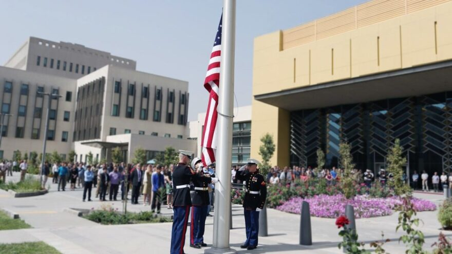 Marine guards at the Sept. 11, 2017, flag ceremony in the U.S. Embassy compound in Kabul, Afghanistan. An internal State Dept. memo says it is the largest U.S. embassy in the world.