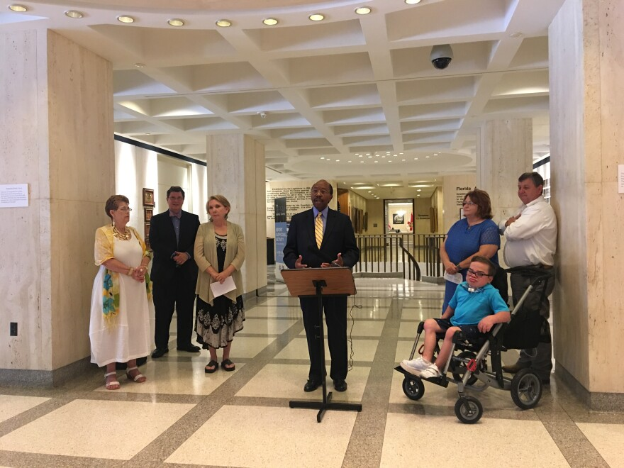 City Commissioner Curtis Richardson spoke outside of Governor Rick Scott's office in the Florida Capitol.