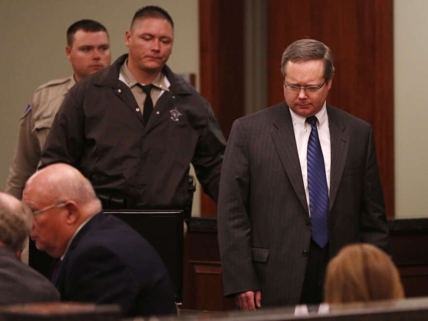 Eric Williams (right) makes his way into the courtroom on the second day of his capital murder trial at the Rockwall County Courthouse in Rockwall, Texas, on Tuesday.