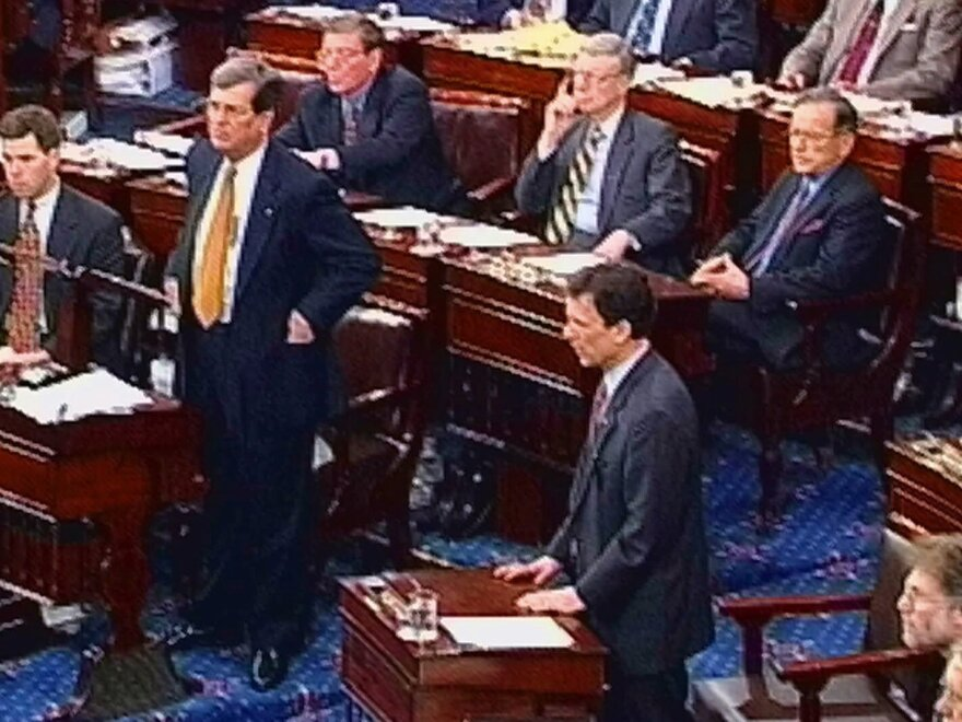 Senate Majority Leader Trent Lott and Minority Leader Tom Daschle, shown in this video image from February 1999, speak during the impeachment trial of President Bill Clinton on the Senate floor.