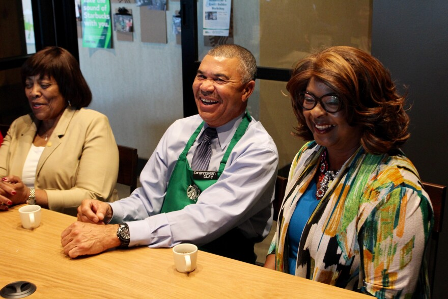 Congressman Lacy Clay has a laugh at a recently-opened Starbucks in Ferguson. He's joined by St. Louis County Councilwoman Hazel Erby, D-University City, (left) and Ferguson Councilwoman Ella Jones.