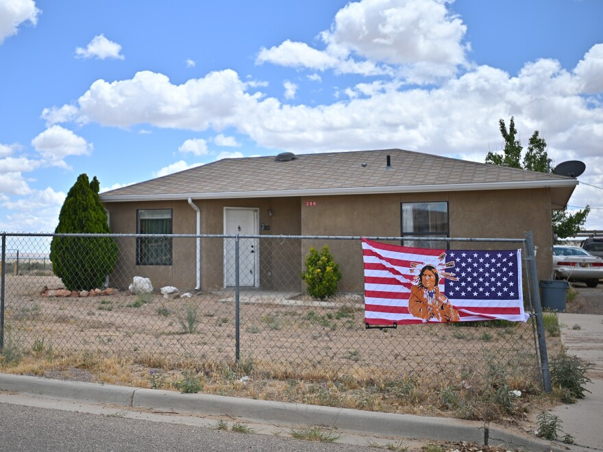 An American flag with an image of a Native American printed on it is attached to a fence outside a home on May 25, 2020 in To'Hajiilee Indian Reservation, New Mexico. The Navajo Nation suffered the highest rate of COVID-19 cases in the U.S. per capita in May. In California, a vaccine allocation committee is considering taking historical injustice into account in advance of a statewide rollout.