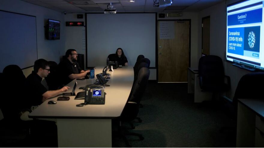Guilford County Emergency Management Coordinators Conor Bake (left), Taylor Jones and Catherine Hughes listen to a webinar presented by Division Director Don Campbell from his office in Greensboro during the response to the COVID-19 pandemic on Thursday, May 14.