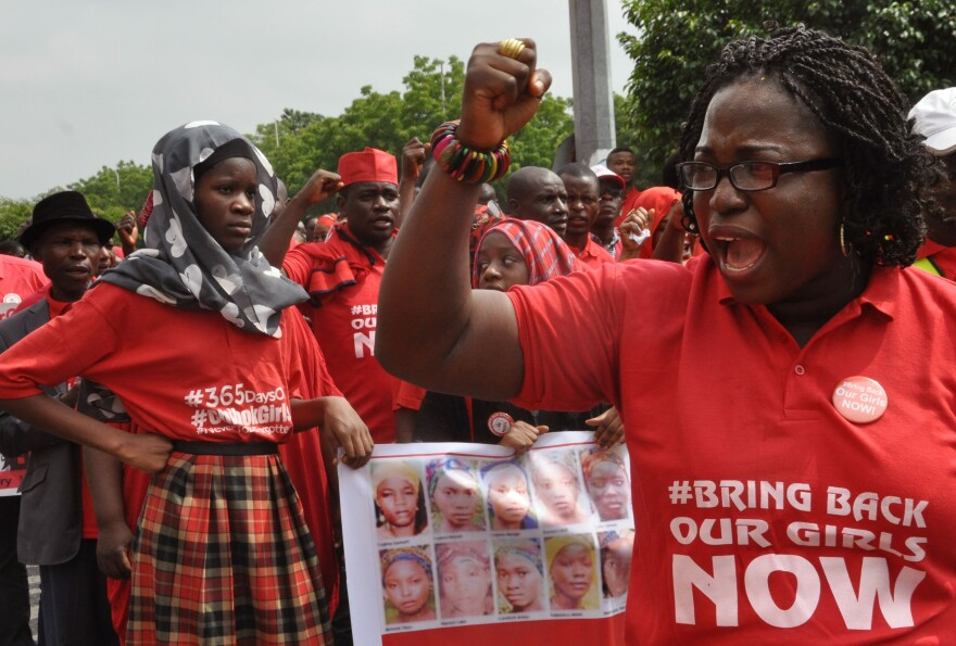 People take part in a march outside the presidential residence in Abuja in 2015, part of the Bring Back Our Girls campaign, in memory of girls abducted by Nigerian extremists.