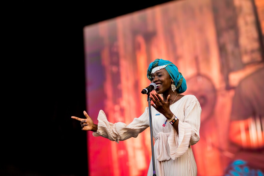 Slam poet and UNHCR Goodwill Ambassador Emi Mahmoud performs at the Sziget Festival in Hungary in 2019.