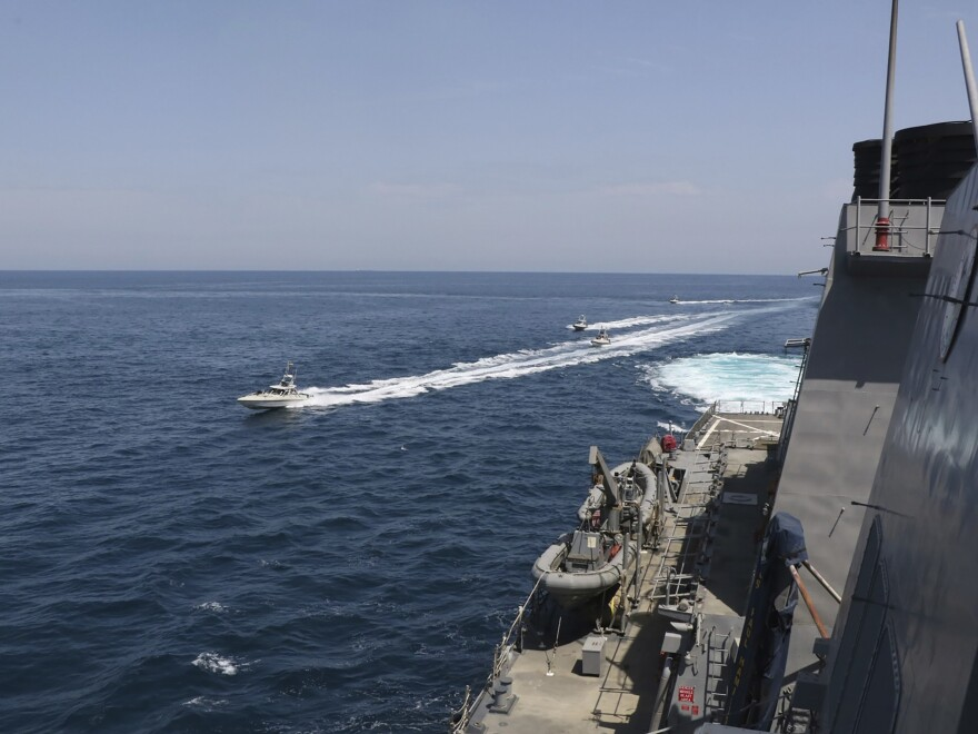 "In this Wednesday photo made available by U.S. Navy, Iranian Revolutionary Guard vessels sail close to U.S. military ships in the Persian Gulf near Kuwait. Eleven Iranian naval vessels made ""dangerous and harassing"" maneuvers near U.S. ships in the Gulf on Wednesday, U.S. officials said. Iranian officials did not immediately acknowledge the incident."