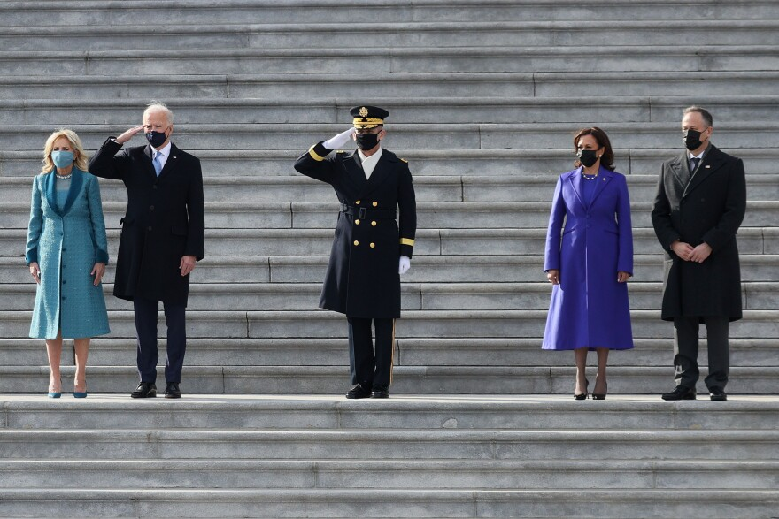 President Biden, first lady Jill Biden, Vice President Harris and second gentleman Doug Emhoff attend a Pass in Review ceremony, hosted by the Joint Task Force-National Capital Region on the East Front of the U.S. Capitol after the inauguration ceremony on Wednesday.