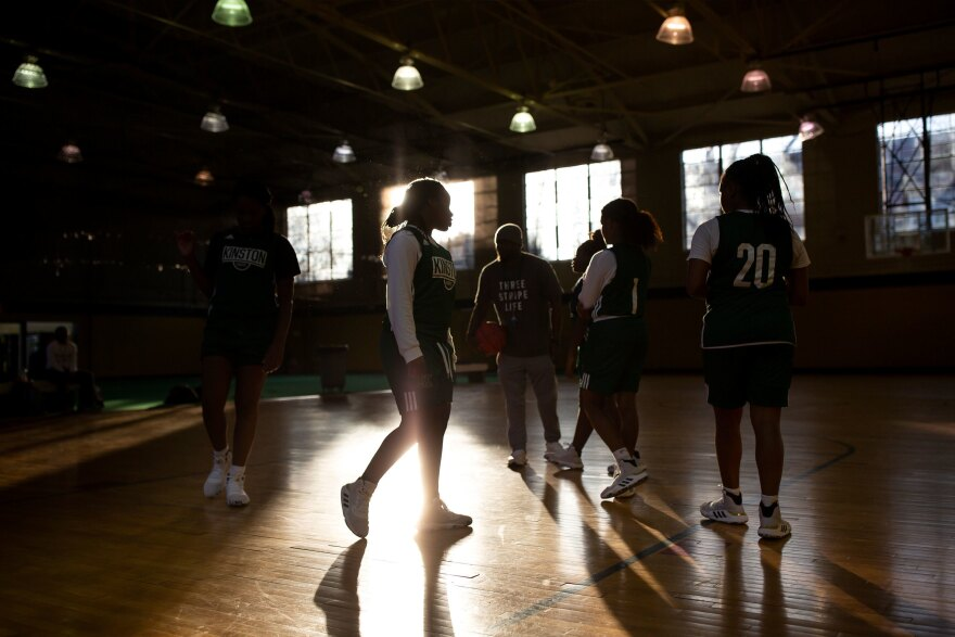 "Michyla Dove and her teammates practice at a community gym. Dove says, ""I wouldn't be who I am today had I not met these girls."""