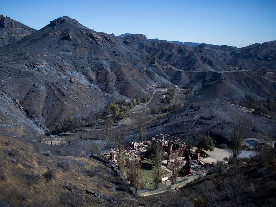 The Santa Monica Mountains, seen here last week, stand blackened and barren after the Woolsey Fire left but few patches of green behind in Malibu, Calif.