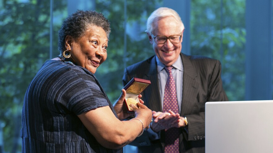Former Poetry Foundation President Henry Bienen (right) awarding a lifetime achievement prize to poet Marilyn Nelson (left). Bienen stepped down from the Poetry Foundation after poets and activists criticized the organization's response to the police killing of George Floyd.