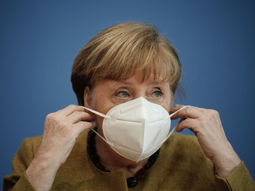 German Chancellor Angela Merkel puts on her face mask after a press conference in Berlin last week. Germany has introduced new requirements for medical-grade masks to be worn on public transit and in shops.